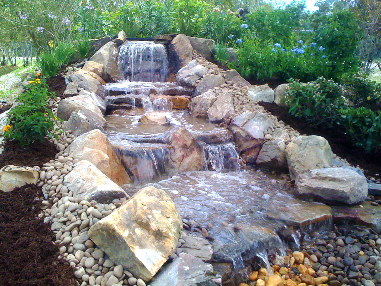 Waterfalls fountains koi ponds lombardo landscaping for Waterfall features for ponds